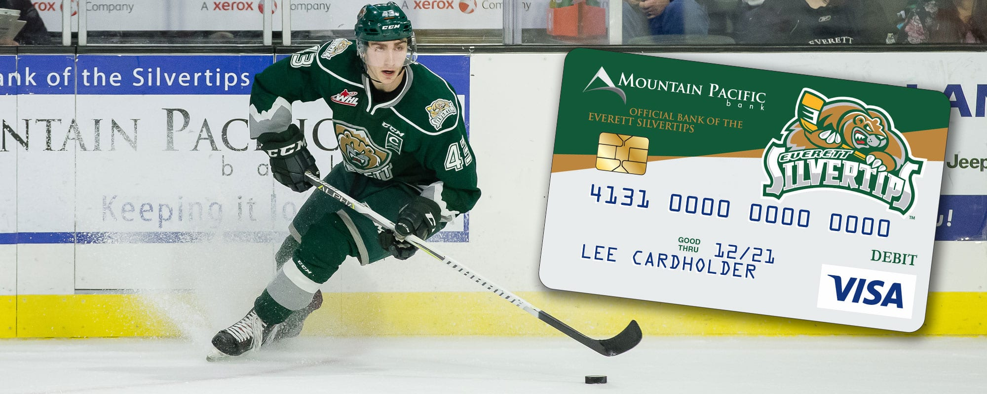 Silvertips Debit Card over picture of Silvertips Hockey Player skating with puck